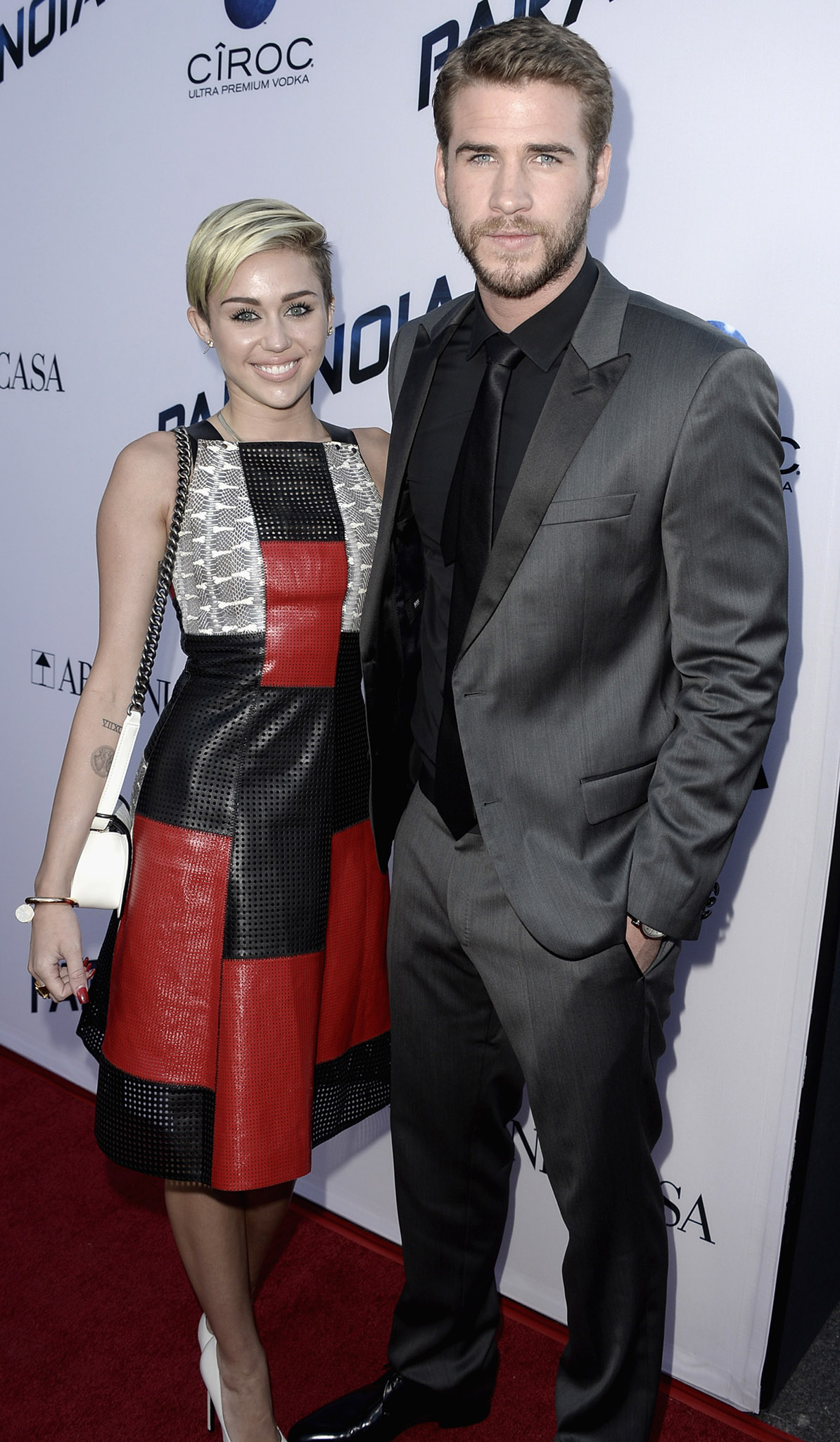 Miley Cyrus attends the 'Paranoia' premiere with Liam Hemsworth (Getty Images)