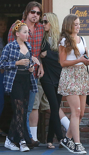 Billy Ray and Tish Cyrus leave an eatery with daughter Noah and a friend. (AKM GSI)