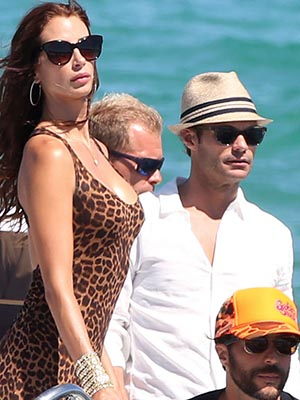 Ryan Seacrest hangs with a mystery brunette (FameFlynet)