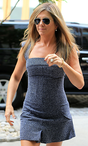 Jennifer Aniston, flashing her engagement ring, out in NYC on Saturday. (Jackson Lee/Splash News)