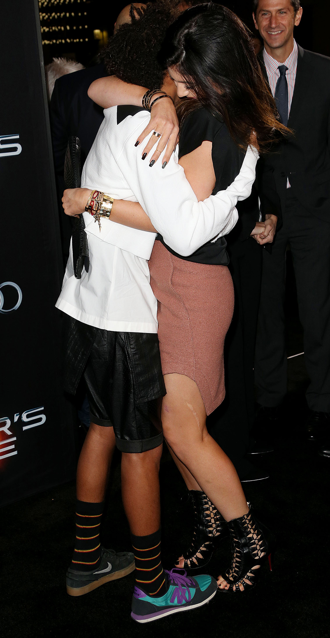 Smith and Jenner hug it out at the 'Ender's Game' premiere (Getty Images)