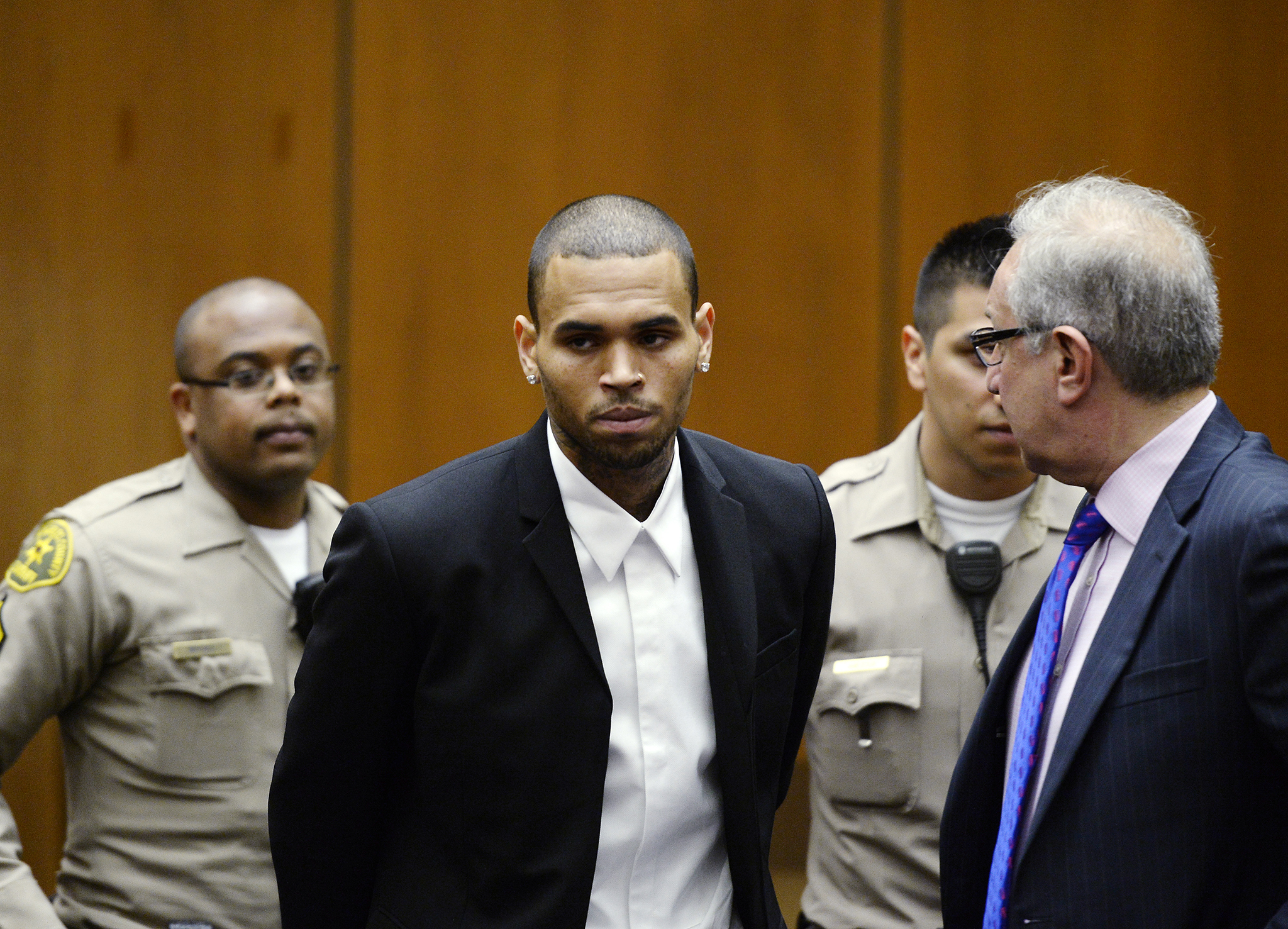 Chris Brown looks unhappy in court on August 16, 2013 (Getty Images)