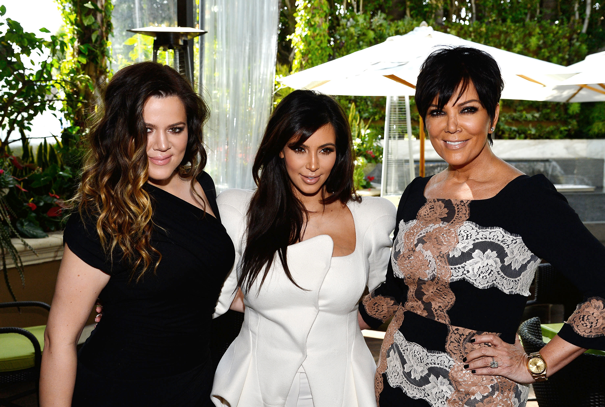 Khloé and Kim Kardashian pose with momager Kris Jenner. (Getty Images)