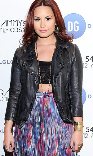 Demi Lovato says she wants to be a role model now. Vivien Killilea/WireImage
