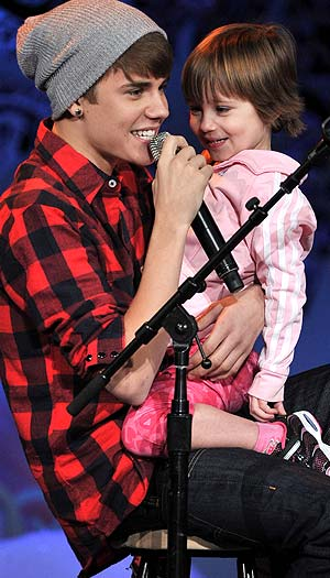 Justin Bieber and sister Jazmyn take the stage. George Pimentel/WireImage