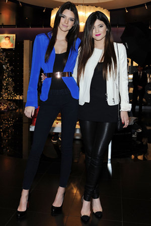 Kendall and Kylie Jenner pop a pose. (Denise Truscello/WireImage)