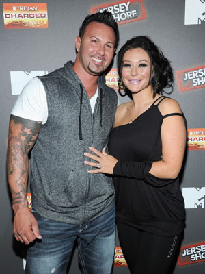 Jenni JWoww Farley and Roger Mathews mug for the camera. (Jamie McCarthy/Getty Images)