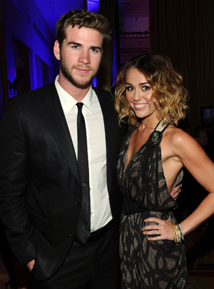 Miley and fiance Liam Hemsworth. (Michael Buckner/Getty Images)