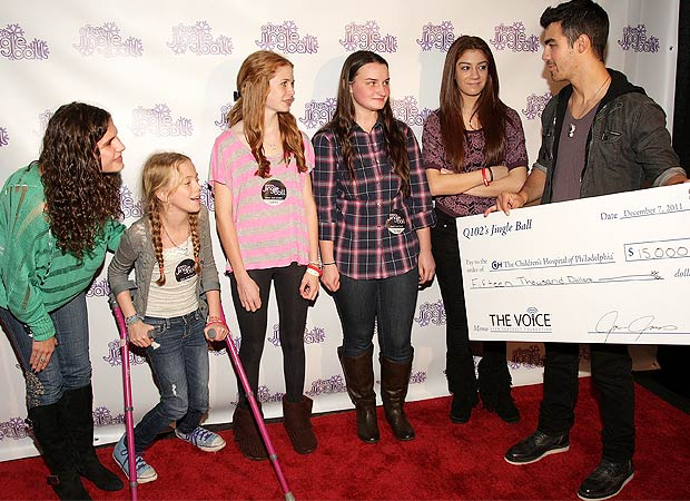 Joe Jonas presents the check. Bill McCay/WireImage