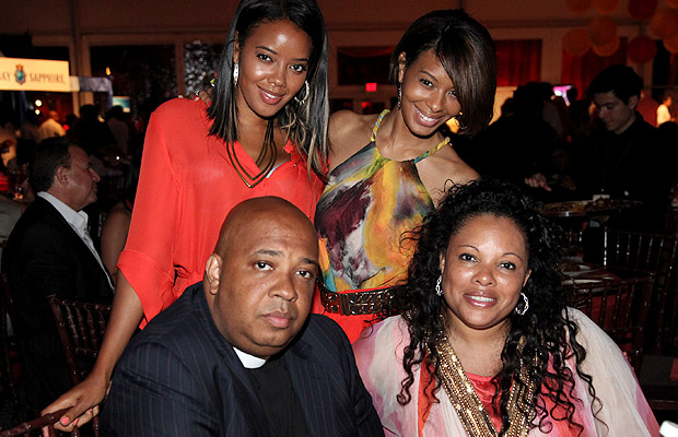 The girls pose with dad Rev Run and stepmother Justine.