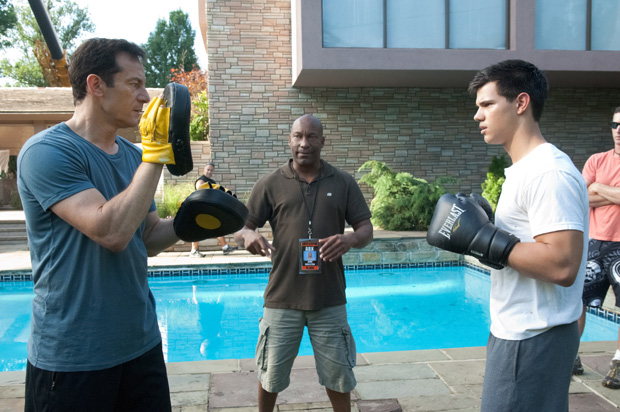 Director John Singleton chimes in as Taylor Lautner shoots a scene with co-star Jason Isaacs. - Bruce Talamon