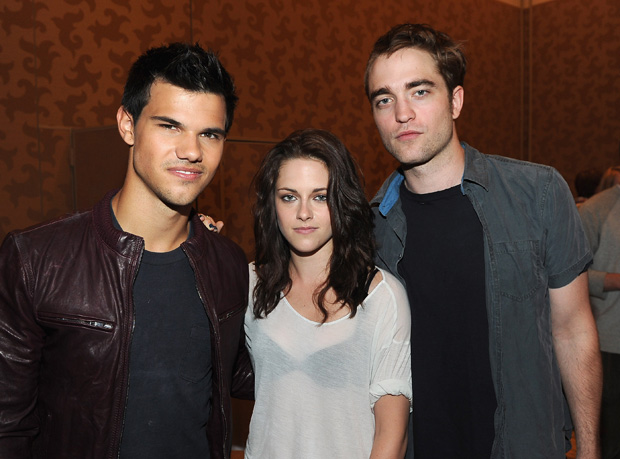 """Twilight"" stars Taylor Lautner, Kristen Stewart, and Robert Pattinson shared the scoop on the upcoming flick at Comic-Con. - Michael Buckner/Getty Images"