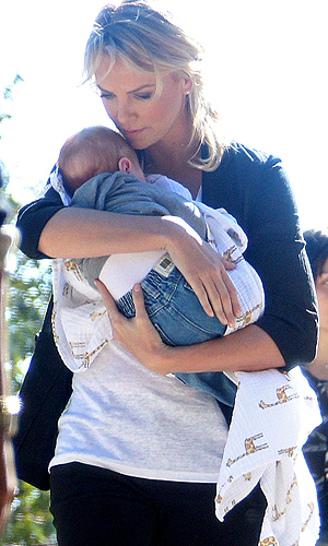 New mommy Charlize Theron practiced with a friend's baby in January. (Kevin Perkins/Pedro Andrade/PacificCoastNews.com)