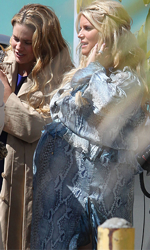 Simpson wore a blue snakeskin-print dress to her baby shower.(Miguel/Goodwin/FameFlynet Pictures)