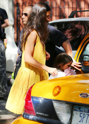 Holmes and Suri cabbed it in NYC on July 25 (Jackson Lee/Splash News)