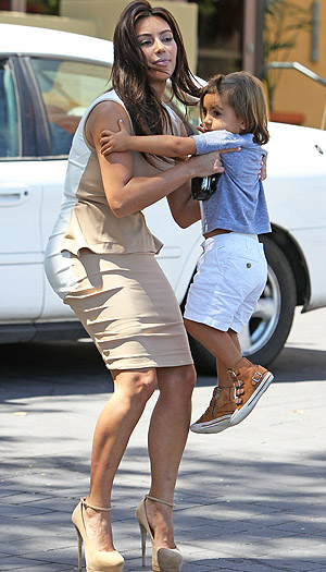 Kim's stilettos didn't stop her from giving Mason a lift (Splash News)