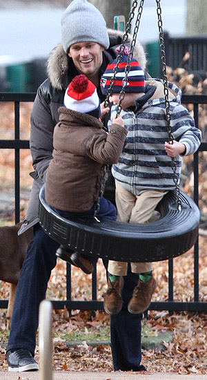 Tom Brady with Benjamin (left) and John (Splash News)