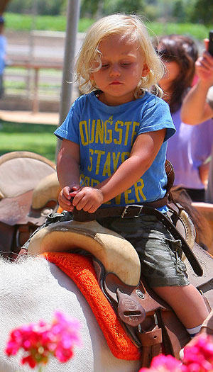Cutie 2-year-old Zuma got a ride on a pony. - INFphoto.com