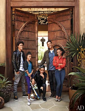 The adobe-style house is meant to be a family retreat for the couple, pictured here with kids (l-r) Trey, Willow, and Jaden. - Art Streiber/Architectural Digest