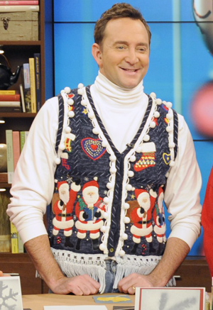 Oh yes he did! Kelly wore an ugly Christmas sweater on 'The Chew.' (Getty Images)