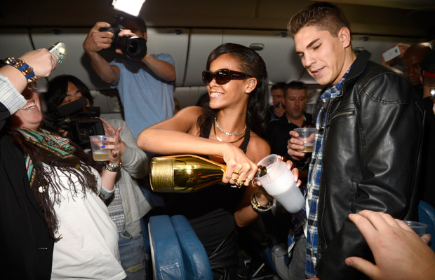 Rihanna pours some bubbly for her devoted fans on Wednesday. (Kevin Mazur/Getty Images)