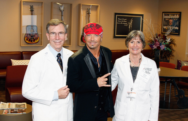 Michaels with doctors in his music room at St. Joseph's Barrow Neurological Institute. (Mike Moore/Getty Images)