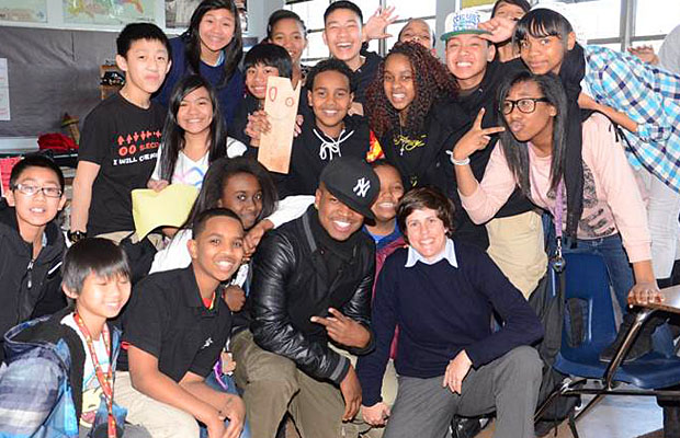 Ne-Yo meets with the students who won Get Schooled's perfect attendance challenge. (Kariba Jack)