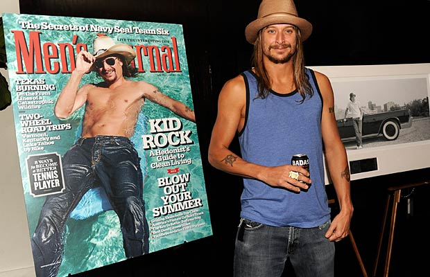 Kid Rock proudly posed with his Men's Journal cover -- as well as a can of his Badass American Lager -- at a NYC soiree. - Kevin Mazur/WireImage.com