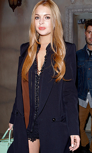 Lohan leaving the club. (Maciel/X17online.com)
