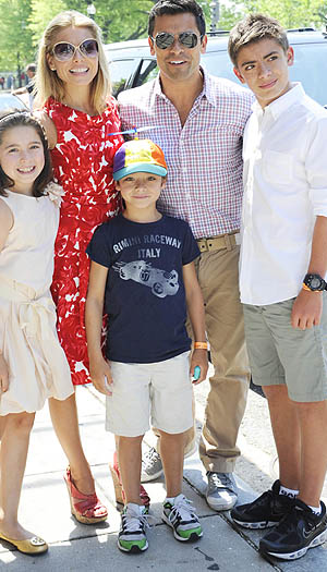 Kelly with hubby Mark Consuelos and kids Lola, Joaquin, and Michael. (PAPSFIRST/Splash News)