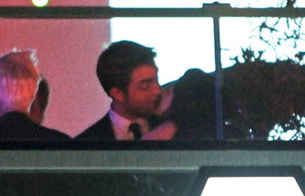Stewart and Pattinson pucker up in public. (Celebuzz.com)
