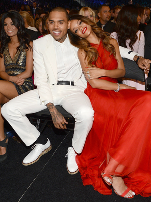 Chris Brown and Rihanna cozy up at this year's Grammys (Getty Images)