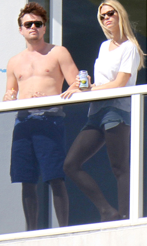 Leo and a blonde. (Pixel Photo Miami/Splash News)