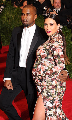 Kanye West and Kim Kardashian arrive at the Met Ball (Getty Images)