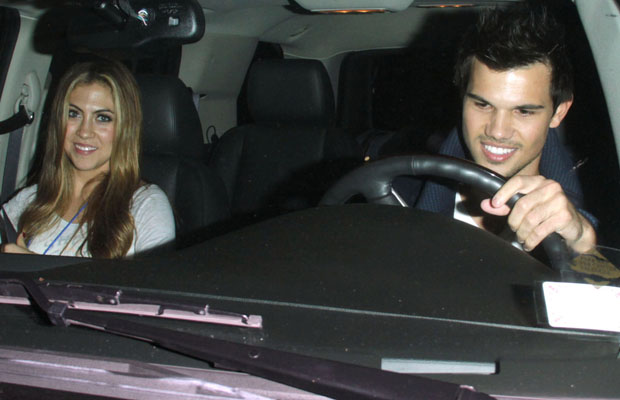 Taylor Lautner and Sara Hicks on Wednesday. (Greg Tidwell/PacificCoastNews.com)