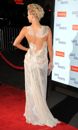 The actress flashes the back of her gown. (Steve Granitz/WireImage)