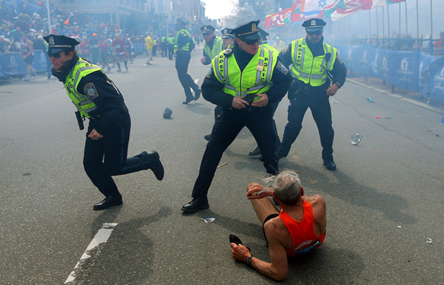 Boston police officers react to the Marathon bombings. (John Tlumacki / AP)