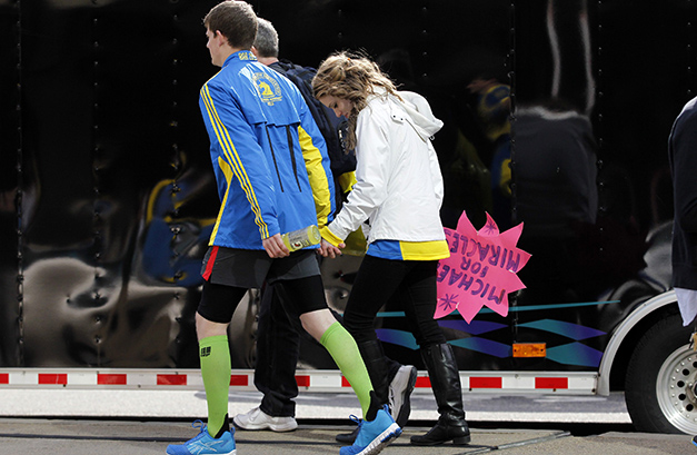 People leave after explosions at the Boston Marathon. (Jessica Rinaldi/Reuters)
