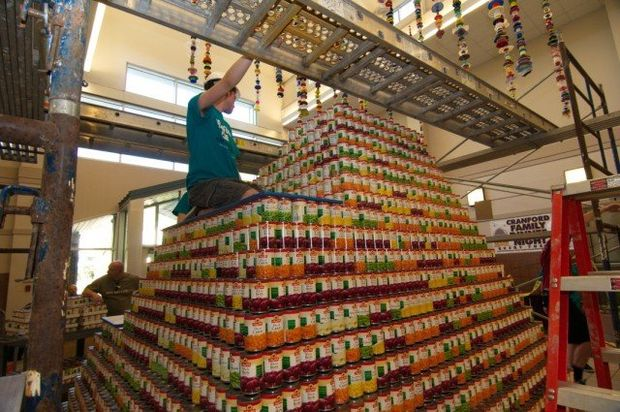 A student on the pyramid of cans. (Jim Occi/NJ.com)