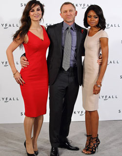 Bond with his girls (new girl Bérénice Marlohe is at left; Naomie Harris, a.k.a. Miss Moneypenny, at right) Jon Furniss/WireImage