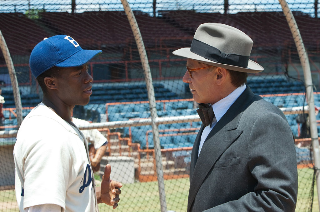 Chadwick Boseman and Harrison Ford in Warner Bros. Pictures' '42'.