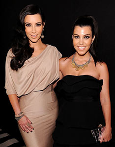 Kim and Kourtney Kardashian (Dimitrios Kambouris/Getty Images)