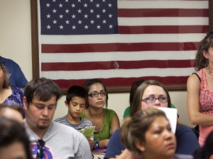 A crowd attends a deferred action meeting (Credit: Getty Images)