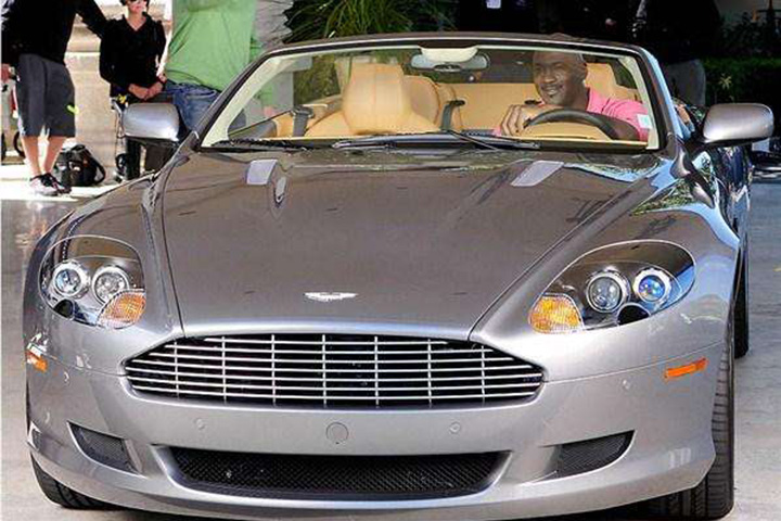 Michael Jordan in his Aston Martin DB9 Volante