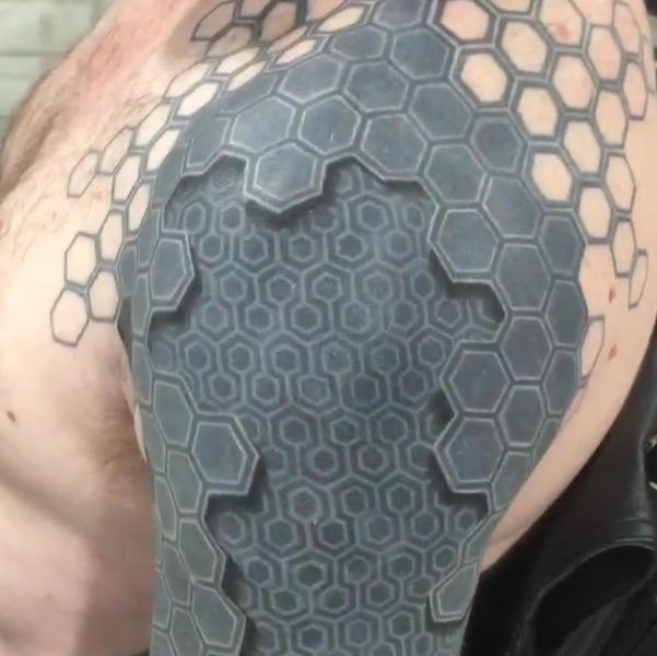 Mind-blowing tattoo makes man look like machine
