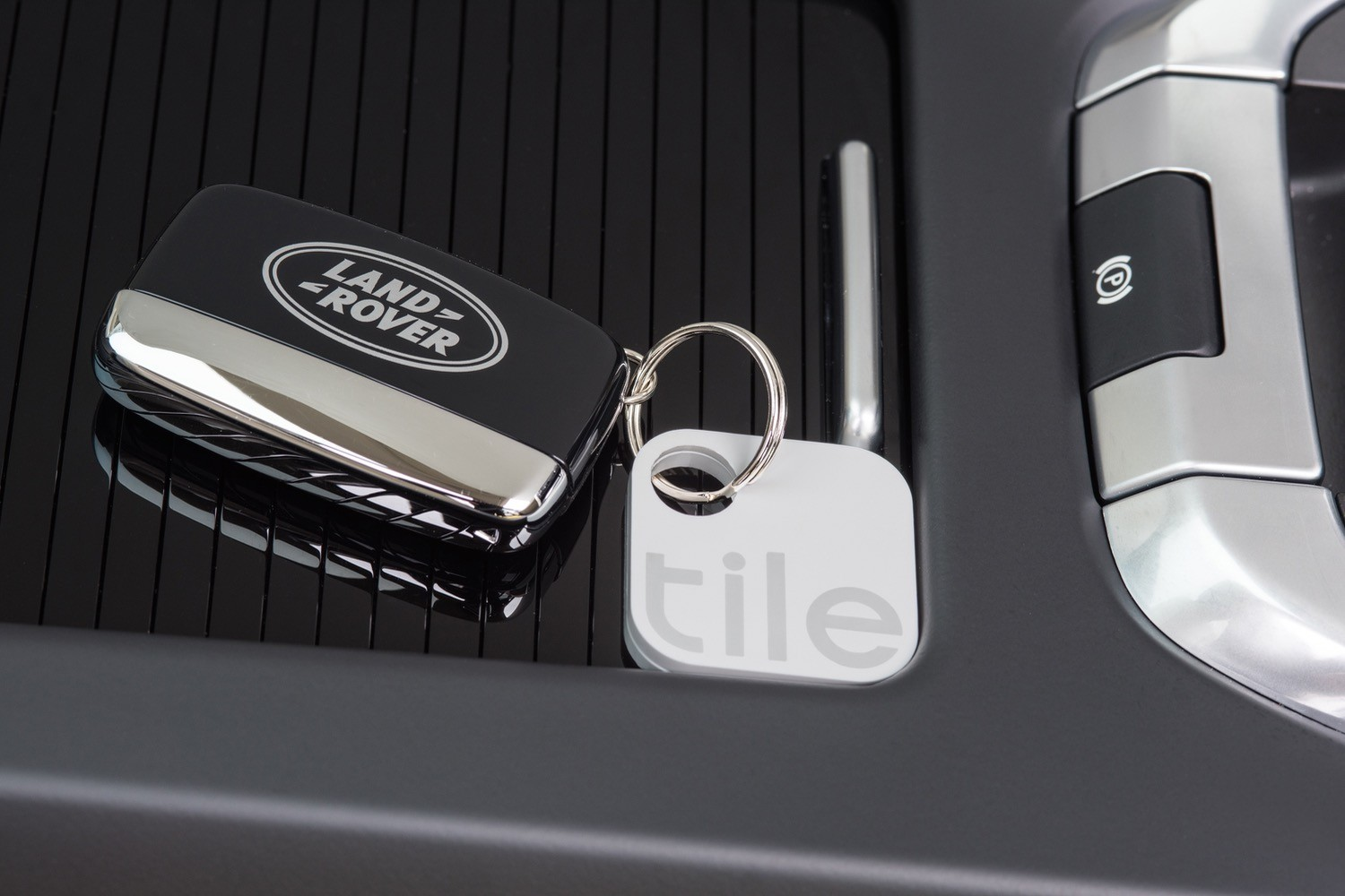 With Tile integration, your Jag or Land Rover can find those lost sunglasses