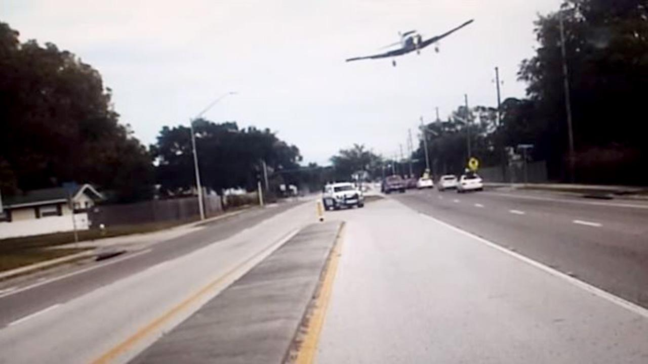 Look Out Below! Plane's Harrowing Crash Caught on Police Dashcam Video