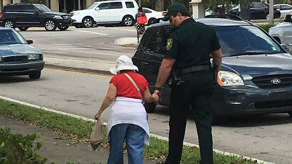 Deputy Walks Elderly Woman Home, Holding Her Hand, in Neighborhood Ravaged by Irma