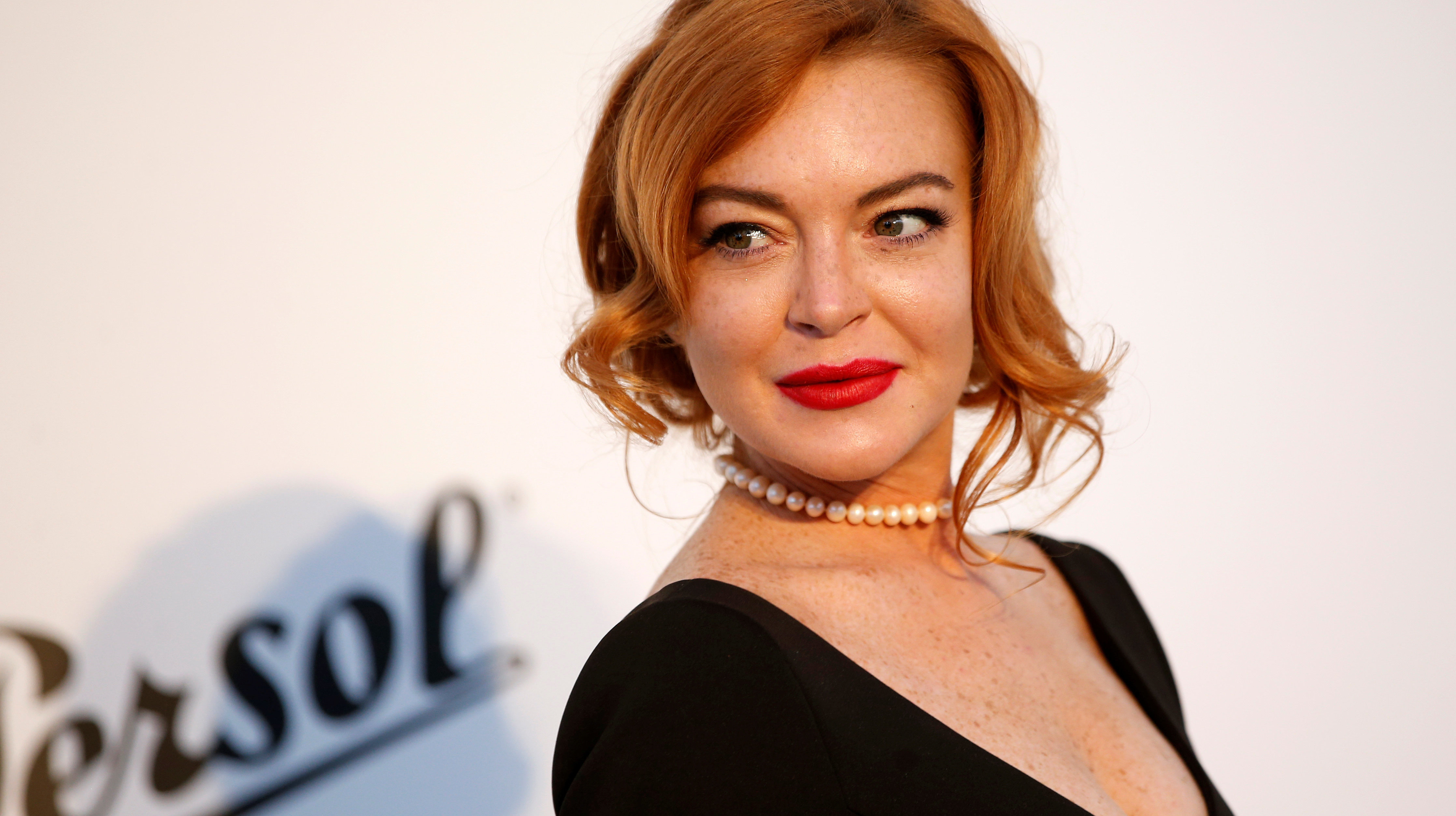 Lindsay Lohan Says Past Relationships With Women Were Part Of 'Living In L.A.'