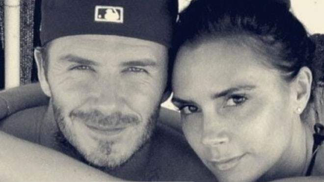 Victoria Beckham Cracks: Famed Frowner Unveils Smile